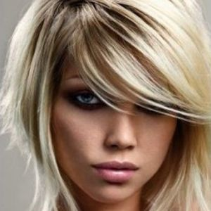 $10.00 OFF! Haircut with Highlights!  April 2015